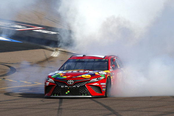 #18: Kyle Busch, Joe Gibbs Racing, Toyota Camry SKITTLES celebrates his win with a burnout