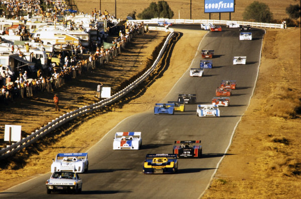 The field is led by the pace car on the formation lap. Brian Redman, Vasek Polak Racing, Porsche 917/10 TC, and Mark Donohue, Penske Racing, Porsche 917/30 TC, make up the front row.