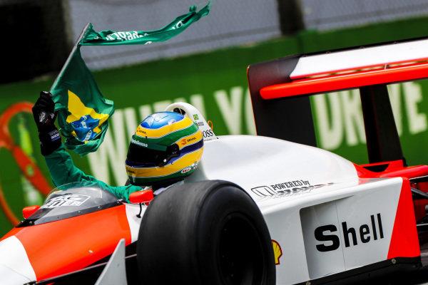 Bruno Senna drives a demonstration run in the McLaren MP4/4 Honda driven by his uncle Ayrton Senna to win the 1988 World Championship