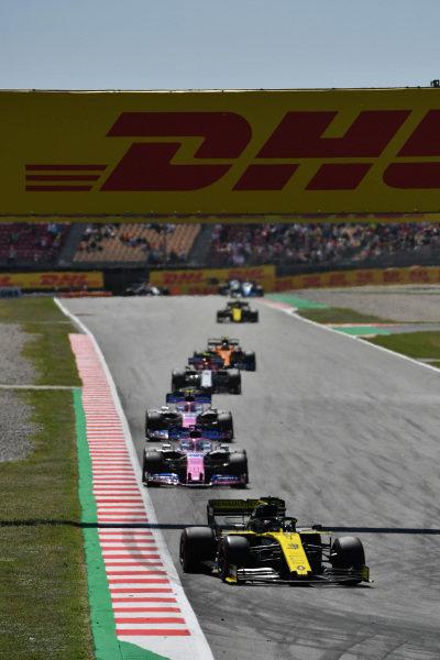 Daniel Ricciardo, Renault R.S.19, leads Sergio Perez, Racing Point RP19, Lance Stroll, Racing Point RP19, and Antonio Giovinazzi, Alfa Romeo Racing C38