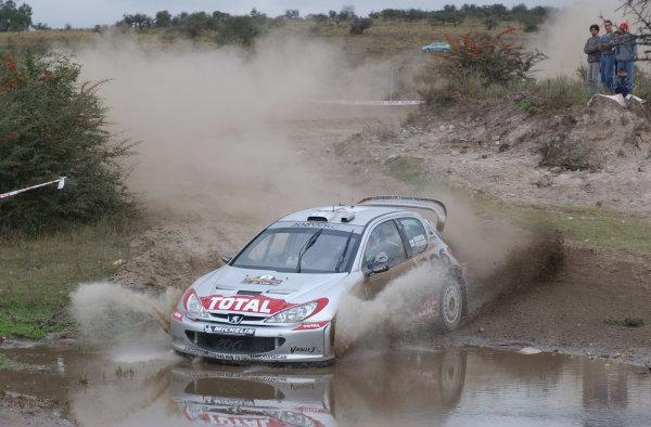 World Rally Championship, Rally of Argentina, May 16-19, 2002.Harri Rovanpera splashes through water on stage 7.Photo: Ralph Hardwick/LAT