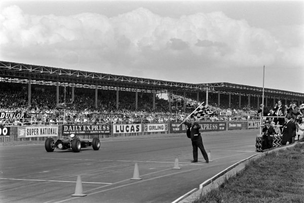 Jackie Stewart, BRM P261, 1st position, takes the chequered flag.