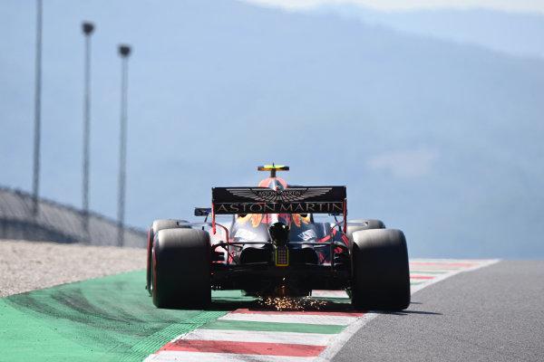 Alexander Albon, Red Bull Racing RB16, leaves sparks behind