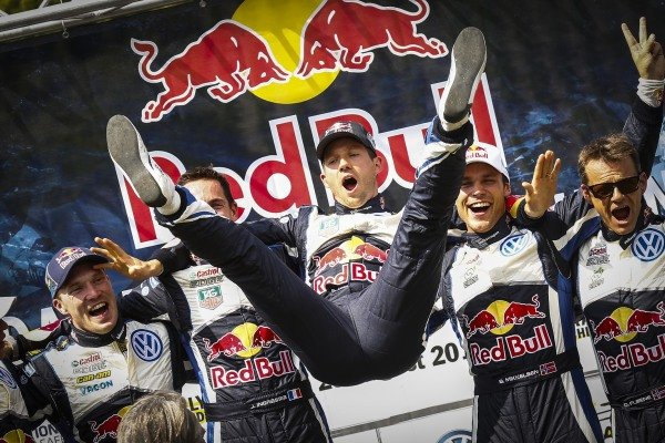 Rally winners Sebastien Ogier (FRA) / Julien Ingrassia (FRA), Volkswagen Polo R WRC, second placed Jari-Matti Latvala (FIN) / Miikka Anttila (FIN), Volkswagen Polo R WRC and third placed Andreas Mikkelsen (NOR) / Ola Floene (NOR) Volkswagen Polo R WRC celebrate on the podium at FIA World Rally Championship, R9, ADAC Rally Deutschland, Day Three, Trier, Germany, 23 August 2015.