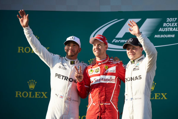 Albert Park, Melbourne, Australia. Sunday 26 March 2017. Lewis Hamilton, Mercedes AMG, 2nd Position, Sebastian Vettel, Ferrari, 1st Position, and Valtteri Bottas, Mercedes AMG, 3rd Position, on the podium. World Copyright: Steve Etherington/LAT Images ref: Digital Image SNE25428