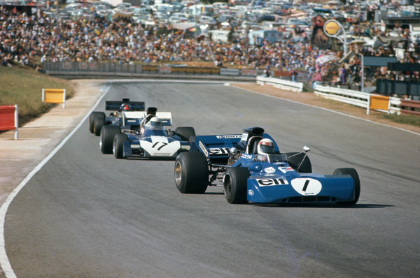 1972 South African Grand Prix.  Kyalami, South Africa. 2-4th March 1972.  Jackie Stewart, Tyrrell 003 Ford, leads Mike Hailwood, Surtees TS9B Ford, and Emerson Fittipaldi, Lotus 72D Ford.  Ref: 72SA03. World Copyright: LAT Photographic