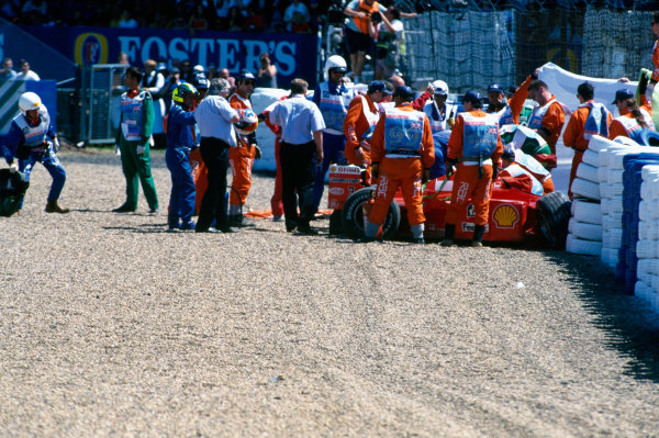 1999 British Grand Prix. Silverstone, England. 9th - 11th July 1999. Michael Schumacher (Ferrari F399), crashes heavily into the tyre barriers at Stowe on the first lap, breaking his leg. World Copyright: LAT Photographic.  Ref:  99_GB_MS_Crash_06.