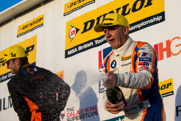 2015 British Touring Car Championship, Silverstone, Northamptonshire, England. 26th - 27th September 2015. Rob Collard (GBR) WSR BMW 125i M Sport, 2nd position, on the podium. World Copyright: Zak Mauger/LAT Photographic. ref: Digital Image _L0U4885