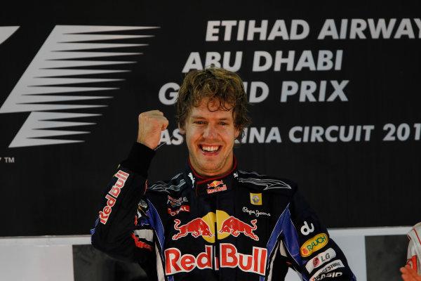 Yas Marina Circuit, Abu Dhabi, United Arab Emirates 14th November 2010. New world champion Sebastian Vettel, Red Bull Racing RB6 Renault, 1st position, on the podium. Portrait. Podium.  World Copyright: Andrew Ferraro/LAT Photographic  ref: Digital Image _Q0C7000