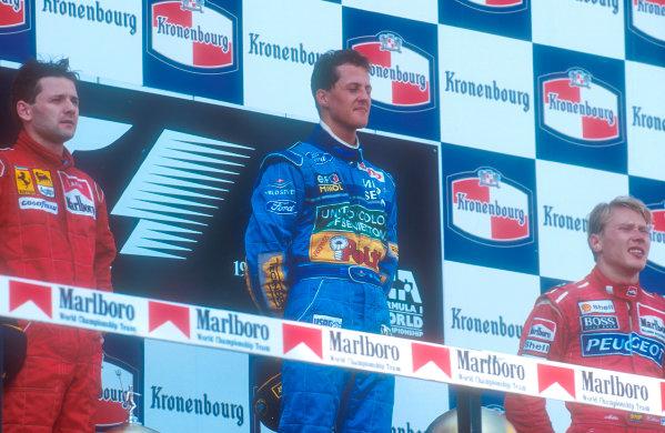 1994 San Marino Grand Prix. Imola, Italy. 29/4-1/5 1994. Michael Schumacher (Benetton Ford) 1st position, Nicola Larini (Ferrari) 2nd position and Mika Hakkinen (McLaren Peugeot) 3rd position on the podium. Ref-94 SM 07. World Copyright - LAT Photographic