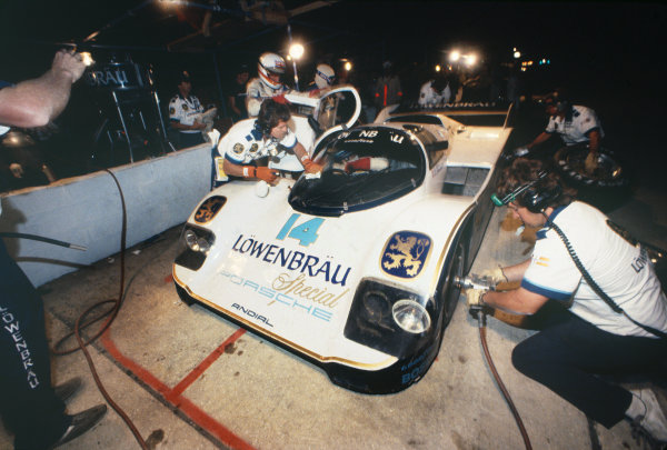 Sebring 12 Hours, Florida, USA.  23rd March 1985. Rd 3. Al Holbert/Derek Bell/Al Unser, Jr. (Porsche 962), 2nd position, pit stop at night, action.  World Copyright: LAT Photographic. Ref:  85IMSA SEB01.