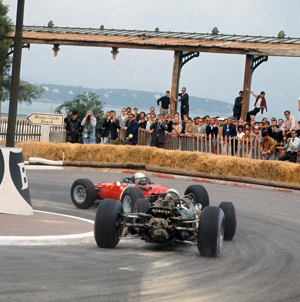 1965 Monaco Grand Prix. Monte Carlo, Monaco. 28-30 May 1965. Lorenzo Bandini (Ferrari 1512) leads Jack Brabham (Brabham BT11 Climax). Bandini finished in 2nd position. Ref-3/1621. World Copyright - LAT Photographic