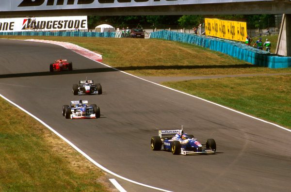 Hungaroring, Hungary.8-10 August 1997.Jacques Villeneuve heads into Turn 2 followed by Damon Hill (Arrows A18 Yamaha), Mika Hakkinen (McLaren MP4/12 Mercedes) and Eddie Irvine (Ferrari F310B).Ref-97 HUN 32.World  Copyright - LAT Photographic