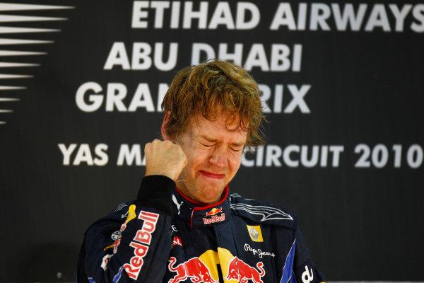Yas Marina Circuit, Abu Dhabi, United Arab Emirates 14th November 2010. New world champion Sebastian Vettel, Red Bull Racing RB6 Renault, 1st position, on the podium. Portrait. Podium.  World Copyright: Glenn Dunbar/LAT Photographic  ref: Digital Image _G7C9779