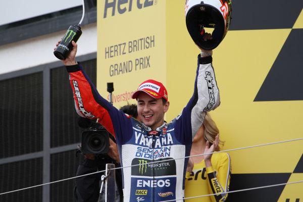 British Grand Prix.  Silverstone, England. 30th August - 1st September 2013.  Jorge Lorenzo, Yamaha, celebrates on the podium.  Ref: IMG_2457a. World copyright: Kevin Wood/LAT Photographic
