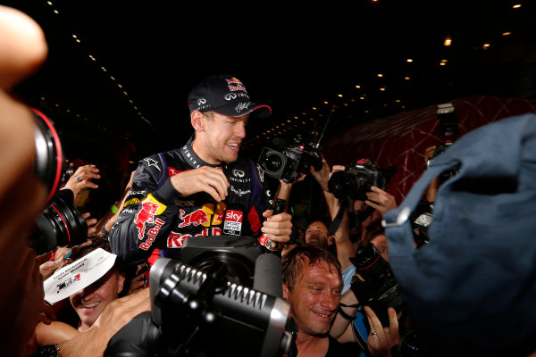 Buddh International Circuit, New Delhi, India. Sunday 27th October 2013. Sebastian Vettel, Red Bull Racing, 1st position, celebrates with fans after securing fourth drivers world title. World Copyright: Charles Coates/LAT Photographic. ref: Digital Image _N7T5926