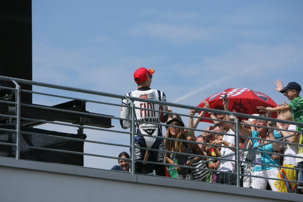Germany Sachsenring 16-18 July 2010Jorge Lorenzo Fiat Yamaha Team cools the crowd down with his runners up champagne