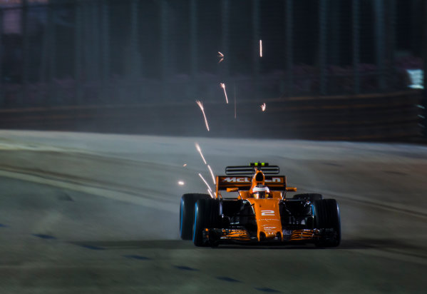 Marina Bay Street Circuit, Marina Bay, Singapore. Sunday 17 September 2017. Stoffel Vandoorne, McLaren MCL32 Honda, throws up sparks. World Copyright: Zak Mauger/LAT Images ref: Digital Image _X0W5908
