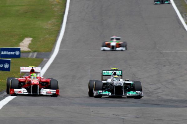 Nurburgring, Germany24th July 2011Nico Rosberg, Mercedes GP W02, 7th position, leads Felipe Massa, Ferrari 150° Italia, 5th position. Action. World Copyright:Glenn Dunbar/LAT Photographicref: Digital Image C27C4509