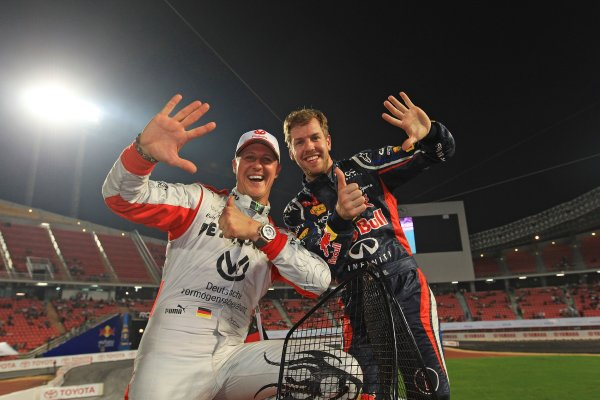 Rajamangala Stadium, Bangkok, Thailand 13th - 16th December 2012 Michael Schumacher and Sebastian Vettel celebrate their sixth win for Team Germany in the Nations Cup World Copyright: IMP (USAGE FREE FOR EDITORIAL PURPOSES ONLY)