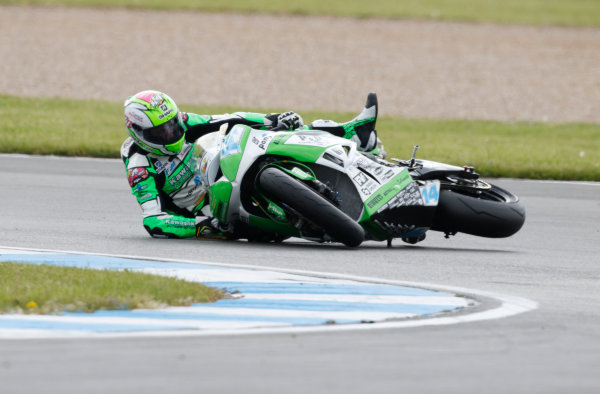2015 World Supersport Championship.  Donington Park, UK.  23rd - 24th May 2015.  Lucas Mahias, Intermoto Kawasaki, crashes at the hairpin.  Ref: KW7_5263a. World copyright: Kevin Wood/LAT Photographic