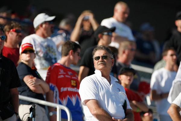 13-16 October, 2011, Las Vegas, Nevada USASubdued fans watch the five lap tribute to Dan Wheldon(c)2011, Phillip AbbottLAT Photo USA