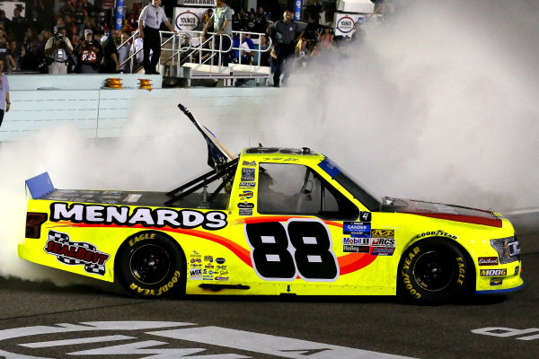 #88: Matt Crafton, ThorSport Racing, Ford F-150 Jack Links/ Menards celebrates his championship win with a burnout