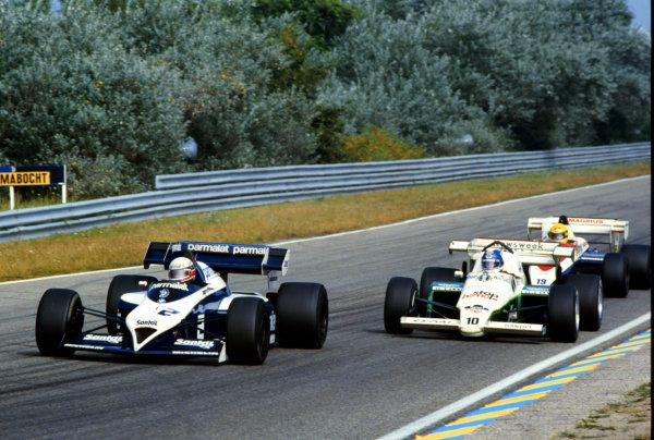 1984 Dutch Grand Prix.Zandvoort, Holland.24-26 August 1984.Teo Fabi (Brabham BT53 BMW) leads Jonathan Palmer (RAM 02 Hart) and Ayrton Senna (Toleman TG184 Hart).World Copyright - LAT Photographic
