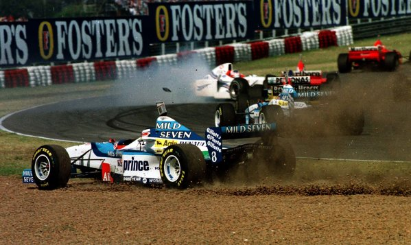 1997 Argentinian Grand Prix.Buenos Aires, Argentina.11-13 April 1997.Gerhard Berger (Benetton B197 Renault) is forced off at the start. He recovered to finish in 6th position.World Copyright - LAT Photographic