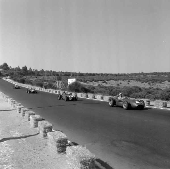 Carroll Shelby, Aston Martin DBR4/250, leads Graham Hill, Lotus 16 Climax.