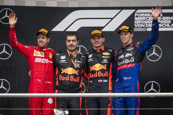 Sebastian Vettel, Ferrari, Race winner Max Verstappen, Red Bull Racing and Daniil Kvyat, Toro Rosso celebrate on the podium