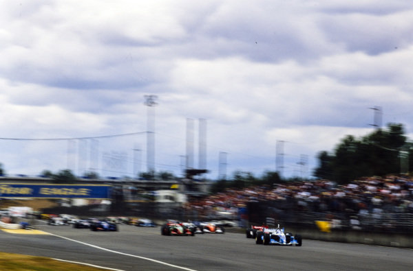 Paul Tracy, Team Player's, Lola B02/00, leads Michel Jourdain Jr, Team Rahal, Lola B02/00, and Mario Dominguez, Herdez Competition, Lola B02/00, at the start.