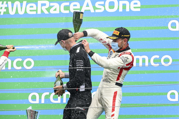 Race winner Luca Ghiotto (ITA, HITECH GRAND PRIX) celebrates on the podium with the champagne