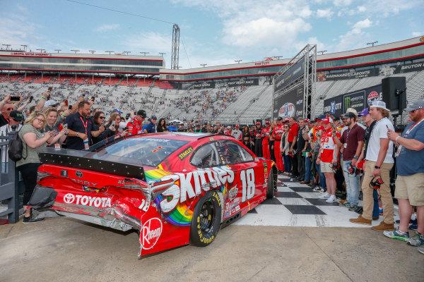 #18: Kyle Busch, Joe Gibbs Racing, Toyota Camry Skittles pulling into victory lane