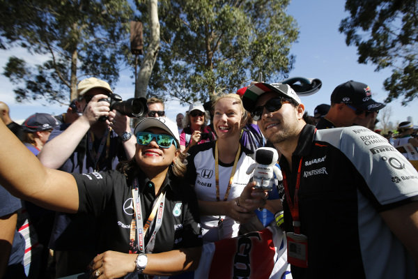 Sergio Perez (MEX) Force India poses for a selfie photo with the fans at Formula One World Championship, Rd1, Australian Grand Prix, Preparations, Albert Park, Melbourne, Australia, Thursday 17 March 2016.