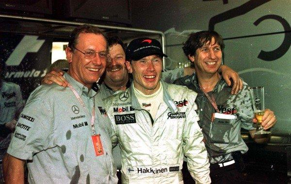 1997 European Grand Prix.Jerez, Spain.24-26 October 1997.Mika Hakkinen (McLaren Mercedes-Benz) celebrates his maiden Grand Prix victory with Dr. Jurgen Hubbert of Daimler-Benz (left) and Mario Illien of Ilmor (right).World Copyright - LAT Photographic