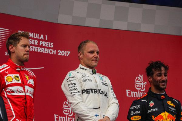Sebastian Vettel (GER) Ferrari, race winner Valtteri Bottas (FIN) Mercedes AMG F1 and Daniel Ricciardo (AUS) Red Bull Racing celebrate on the podium at Formula One World Championship, Rd9, Austrian Grand Prix, Race, Spielberg, Austria, Sunday 9 July 2017.
