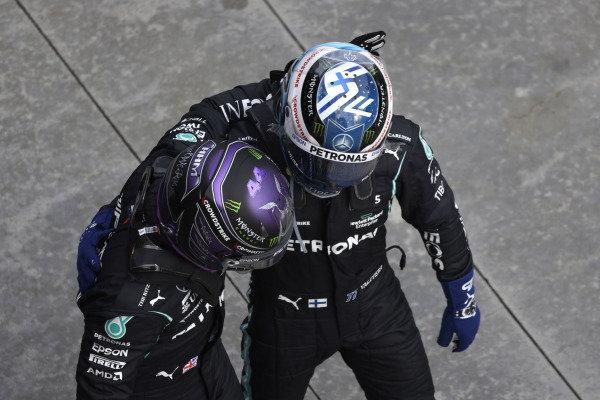 Pole man Sir Lewis Hamilton, Mercedes, is congratulated by Valtteri Bottas, Mercedes, in Parc Ferme