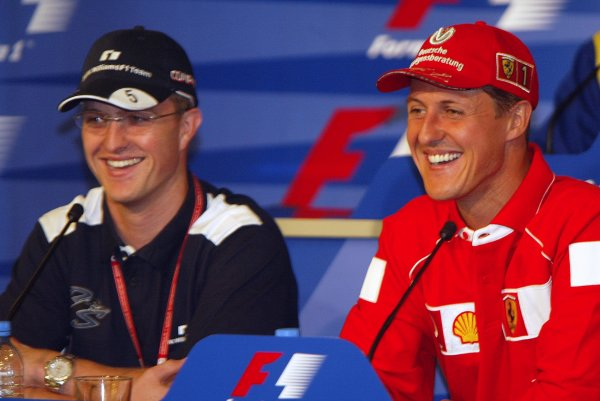 2002 European Grand Prix Grand Prix - PreviewNurburgring, Germany. 20th June 2002Michael Schumacher (Ferrari) with brother Ralf Schumacher (Williams BMW) in a press conference.World Copyright: Steve Etherington/LATref: Digital Image Only