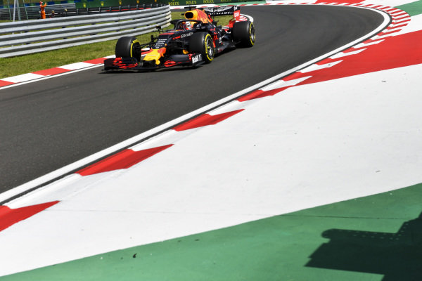 Max Verstappen, Red Bull Racing RB15 drives to the grid