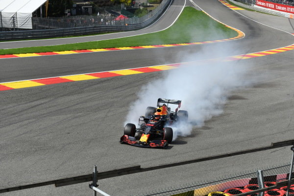Max Verstappen, Red Bull Racing RB15, spears off the circuit due to damage from a collision with Kimi Raikkonen, Alfa Romeo Racing C38