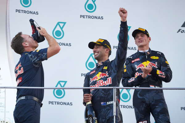 Sepang International Circuit, Sepang, Malaysia. Sunday 2 October 2016. Christian Horner, Team Principal, Red Bull Racing, drinks from the shoe of a delighted Daniel Ricciardo, Red Bull Racing, 1st Position, on the podium. World Copyright: Steve Etherington/LAT Photographic ref: Digital Image SNE14257 1