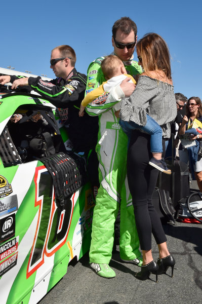 6-8 October, 2016, Concord, North Carolina USA Kyle Busch, Interstate Batteries - ABC Toyota Camry (18) with his son Brexton and wife Samantha Busch. ?2016, John Harrelson / LAT Photo USA