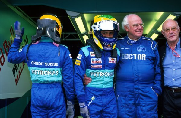 (L to R): Sauber drivers Nick Heidfeld (GER) and Felipe Massa's (BRA) used HANS devices in a race meeting for the first time, as approved by FIA Doctor Sid Watkins (GBR).  Italian Grand Prix, Monza, 16 September 2002. BEST IMAGE