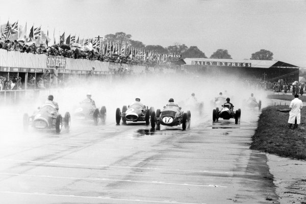 1954 Daily Express International Trophy.Silverstone, Great Britain. 15 May 1954.With Jose Froilan Gonzalez (Ferrari 553) already gone after the start of Heat 1, (left-to-right) Tony Rolt (Connaught A-Lea-Francis), Umberto Maglioli (Ferrari 625), Stirling Moss (Maserati 250F), Alan Brown (Vanwall) and Jock Somervail (Cooper T20-Bristol) follow in the rain.World Copyright: LAT PhotographicRef: Autosport b&W print. Published: Autosport, 21 May 1954 front cover