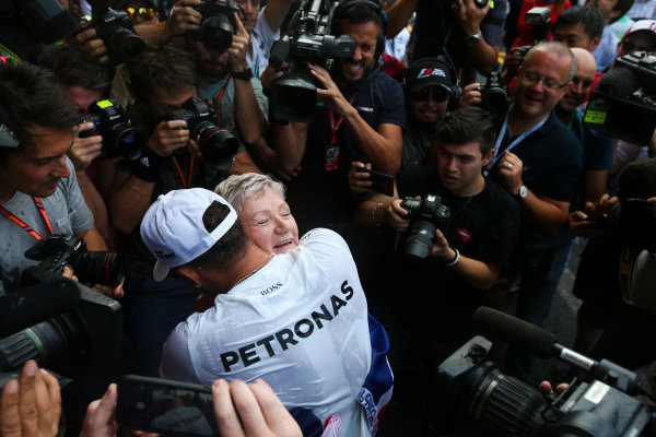 Autodromo Hermanos Rodriguez, Mexico City, Mexico. Sunday 29 October 2017. Lewis Hamilton, Mercedes AMG, celebrates with his mum Carmen Larbalestier, surrounded by photographers and media,after securing his 4th world drivers championship title, and third with Mercedes. World Copyright: Charles Coates/LAT Images  ref: Digital Image DJ5R7919