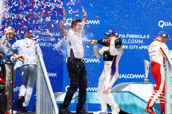 2016/2017 FIA Formula E Championship. Round 10 - New York City ePrix, Brooklyn, New York, USA. Sunday 16 July 2017. Sam Bird (GBR), DS Virgin Racing, Spark-Citroen, Virgin DSV-02, celebrates on the podium after winning the race. Photo: Alastair Staley/LAT/Formula E ref: Digital Image _R3I1738