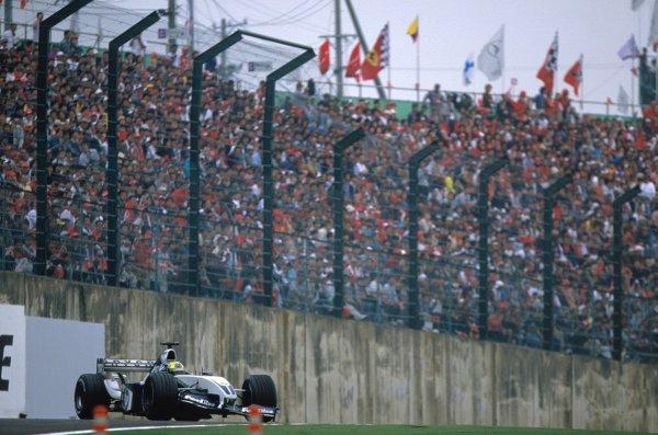 2003 Japanese Grand PrixSuzuka, Japan. 10th - 112th October 2003.Ralf Schumacher, BMW Williams FW25, spins.World Copyright: Steven Tee / LAT Photographic ref: 35mm Image 03JAP34