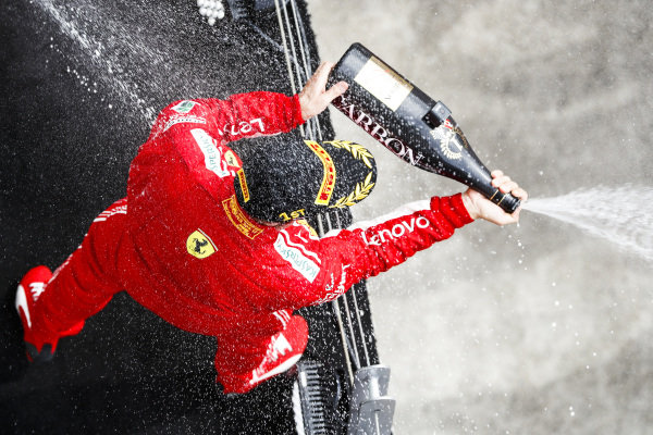 Sebastian Vettel, Ferrari, 1st position, sprays Champagne on the podium.