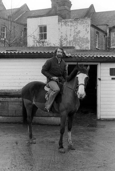 John Watson (GBR) on a horse near his home.